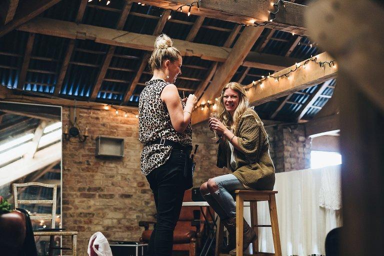 Bride laughing barn wedding