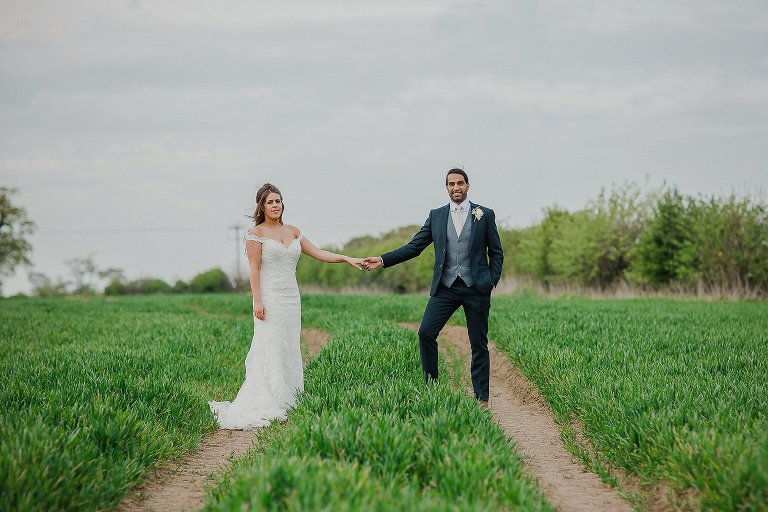 Bride and Groom in field at Priory Cottages Tadcaster