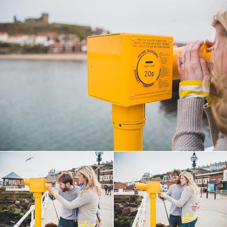 Couple looking through telescope at Whitby
