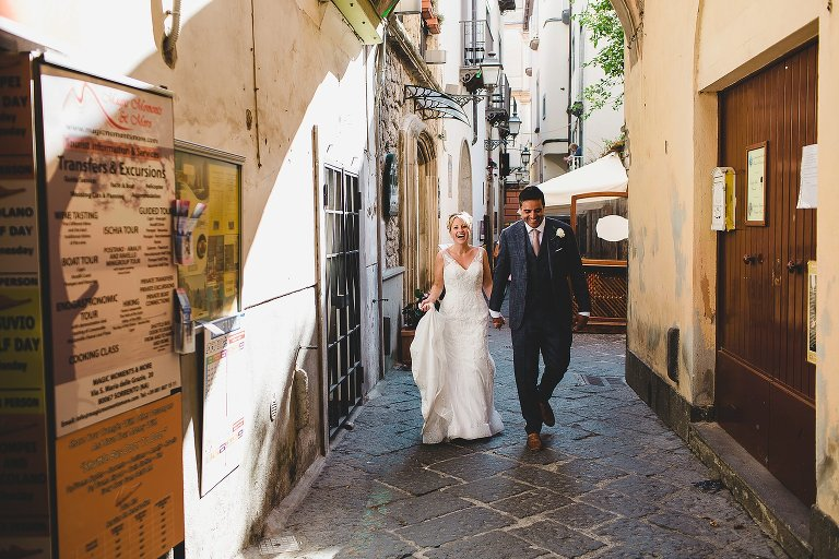 Bride and Groom walking through streets of Sorrento